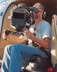 James Cameron on board a helicopter